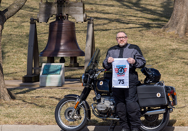Otus, my Grand Tour rally flag, a Liberty Bell replica, and me being squinty